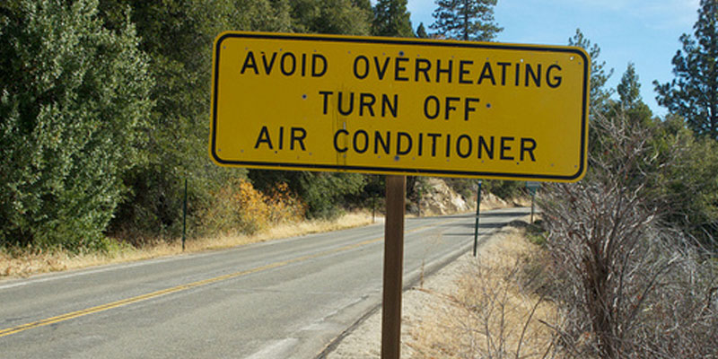 Avoid Overheating Street Sign
