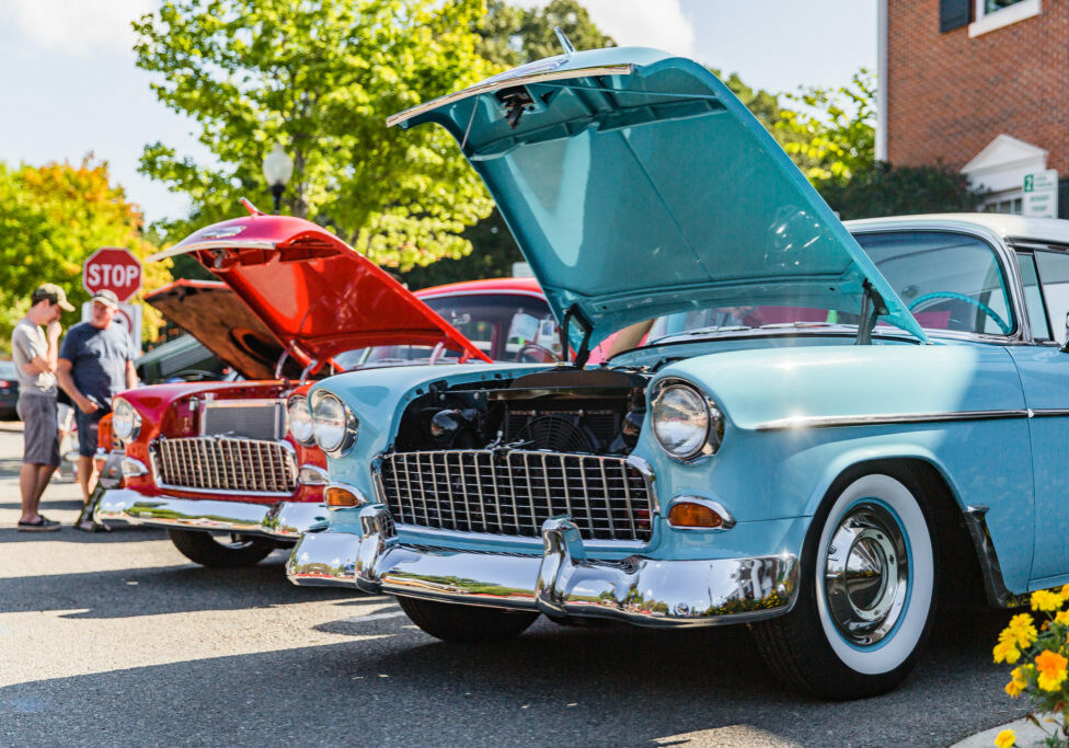 Matthews, North Carolina - September 3, 2018: Visitors admire vintage 1950s era Chevrolet and Ford cars at the Matthews Auto Reunion